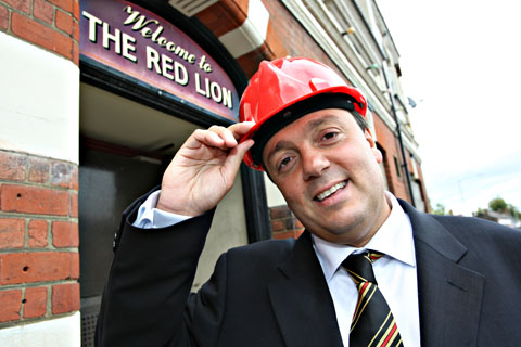 Baz in a hat: Laurence Bassini outside the Yellow and Red Lion pub on Vicarage Road. Picture: Pippa Douglas