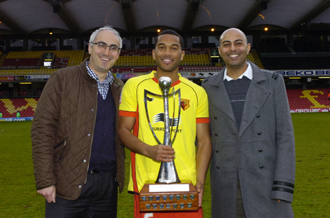 Adrian Mariappa with the Watford Observer Player of the Season Trophy and Terence Ritchie from SA Law and Meeten Nathwani from Hillier Hopkins