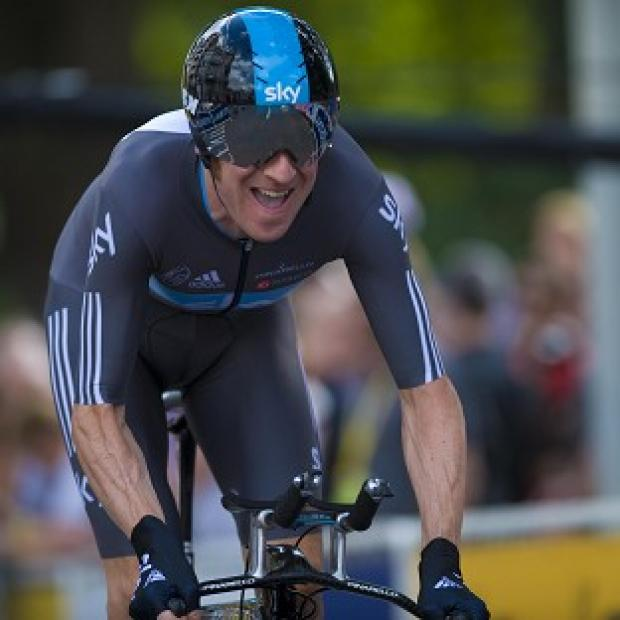 Bradley Wiggins enters his rest day with an advantage of one minute and 53 seconds