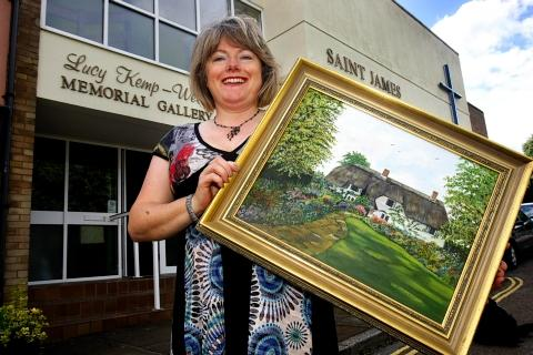 Claire Staniland with one of her mother's pictures.
