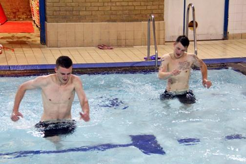 Jets pair Lewis Putman and Luke Beardsworth use the pool for pre-season training