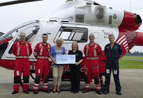 Mrs Ann Buist, 52, was invited to the Herts Air Ambulance Airbase at North Weald to meet the air crew and see the helicopter up close before being presented with her cheque for winning the super-draw.