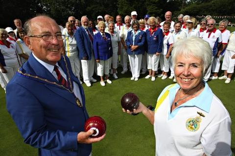 Stuart Lake and Janet Sellek with members of Bushey Bowling Club.