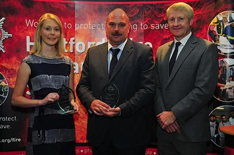 Award winners Alexandra Radley and Dave Elliott with Hertfordshire chief fire officer Roy Wilsher