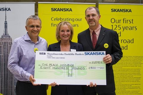 Mike Putnam, Skanska UK's president and CEO, Rachel Fowler, corporate development manager at the Peace Hospice and  Mats Williamson, Skanska AB's executive vice president.