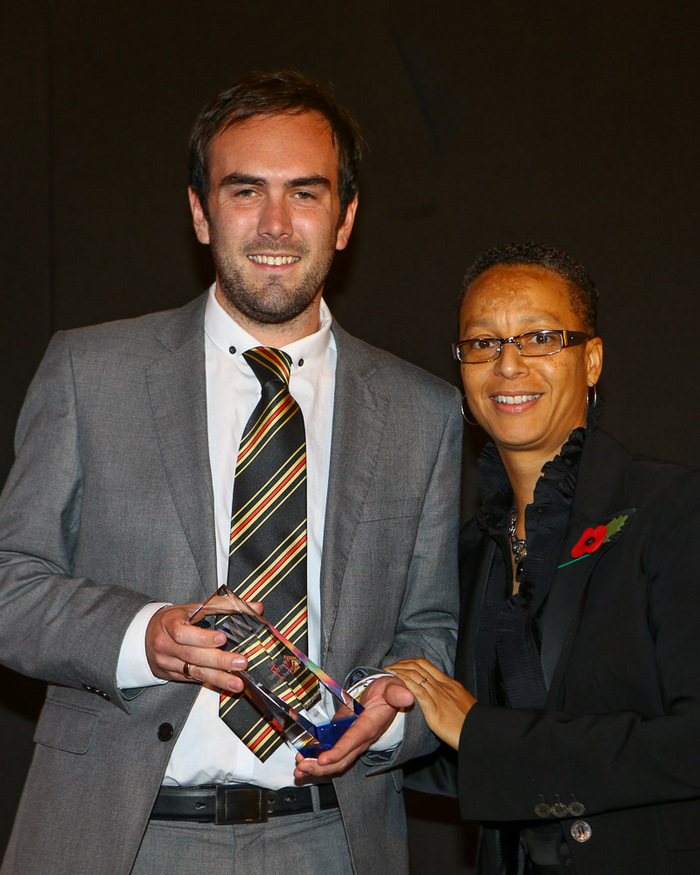 John Salomon receives his award from England coach Hope Powell