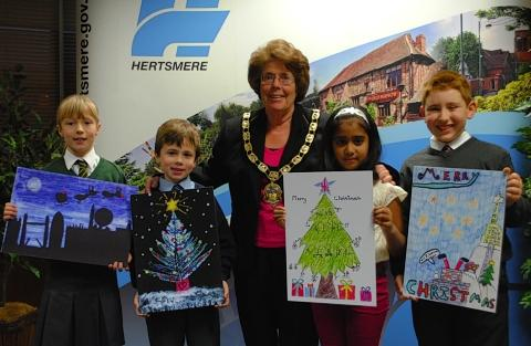 Mayor Cllr Strack, centre, with Christmas card prizewinners, from left, Ellen Harrison (joint third), Sully MacCormack (runner-up), Riya Rajesh (winner) and Ben Fullman (joint third).