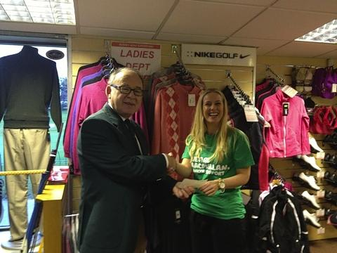 Malcolm Cohen, Captain of the men's golfing section at Bushey Country Club, presents Herts and Essex Fundraising Manager for Macmillan Cancer Support, Kerry Briars with a cheque for £3,264