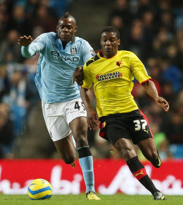 Geoffrey Mujangi Bia takes on Mario Balotelli. Picture: Action Images