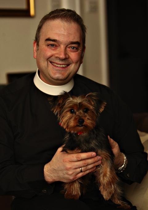 Watford vicar welcomes puppy into parish