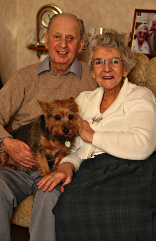 Bob and Enid Saunderson with their Yorkshire terrier, Lizzie