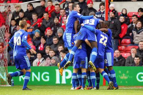 Troy Deeney is mobbed after scoring at Nottingham Forest on Saturday. Picture: Action Images