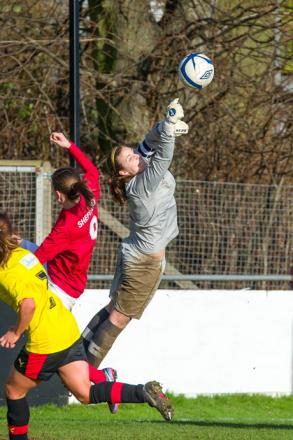 At full stretch: Hornets keeper Lauren Davey. Picture: Andrew Waller.