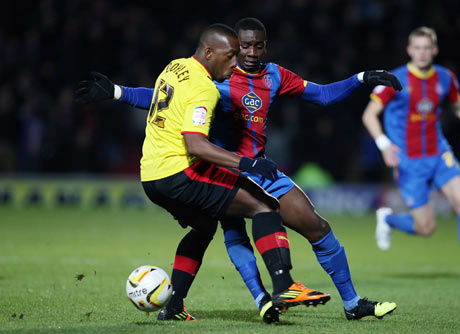Lloyd Doyley challenges Yannick Bolasie in Friday night's draw against Crystal Palace. Picture: Action Images