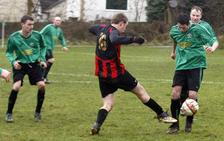 Action from Bovingdon's (green shirts) Ken Simmons Memorial Cup win over Ebury Olympians. Picture: Holly Cant