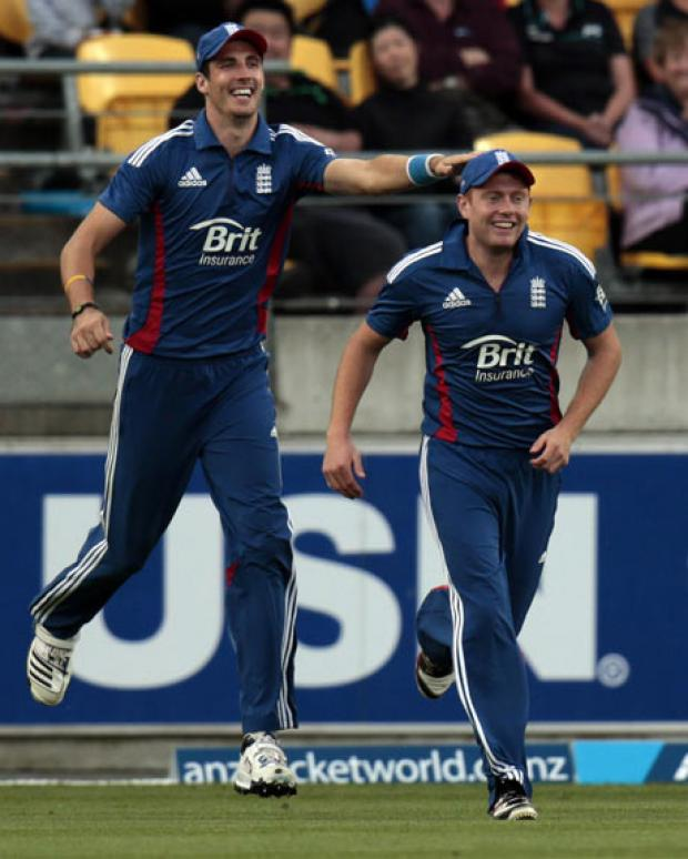 Steve Finn celebrates the wicket of Brendon McCullum with Jonny Bairstow. Picture: Action Images