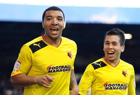Deeney's delight: Watford's two-goal striker celebrates his second with Cristian Battocchio. Picture: Action Images