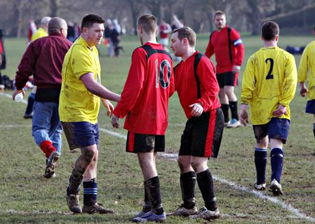 Well played: a scene at the end of AFC Oddfellows' 6-2 win over Woodlands United. Picture: Pippa Douglas