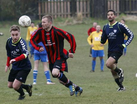 Watford Observer: First to the ball: action from Bushey's (blue shirts) victory over Oakview. Picture: Holly Cant