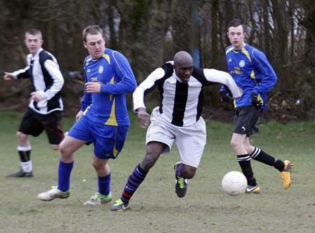 Breaking clear: Pavilion Rangers (striped shirts) easily saw off Headstone Lions 5-0 in Division One. Pictur