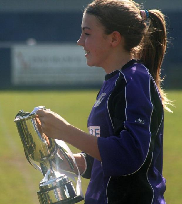 Jordan Littleboy celebrates Garston Ladies Under-14 Mets County Cup win