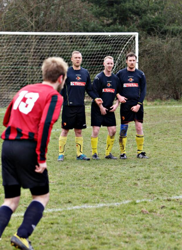 Lining up a free-kick: AFC Bushey Reserves (striped shirts) went down to a 3-1 defeat against Racing Santandome. Picture: Pippa Douglas