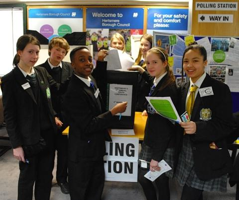 Pupils from Queens' School in Bushey learn about the voting process
