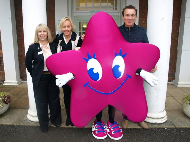 Martin and Shirlie Kemp are pictured with Stellar the Starlight Walk mascot and Sue Plummer, chief executive of the Peace Hospice.