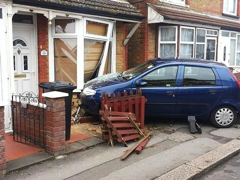 People trapped after car crashes into house