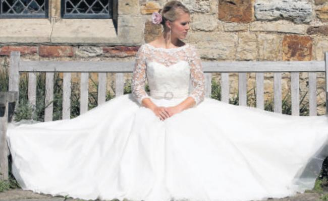 Dreamtime is a full-length dress with a train and organza skirt and overlay, £2,324, from Qiana Bridal, available in white or ivory and up to size 24