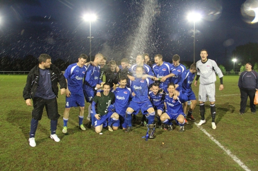 Oxhey Jets celebrate their victory in the South Midlands Floodlit Cup