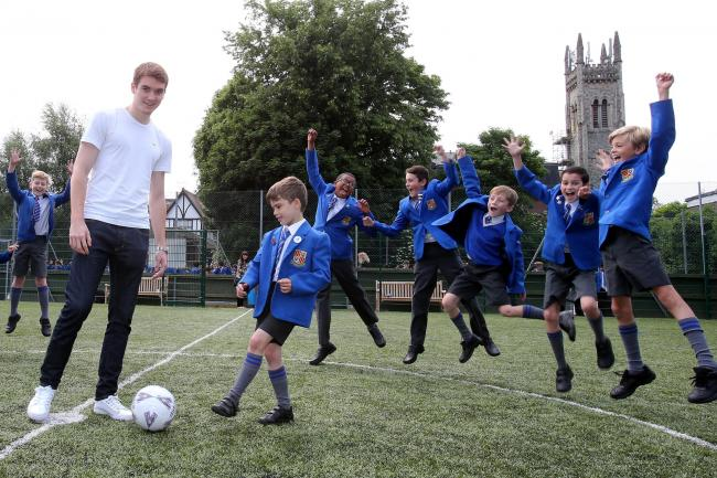 Tommie Hoban with children at Loyola Preparatory School in Buckhurst Hill