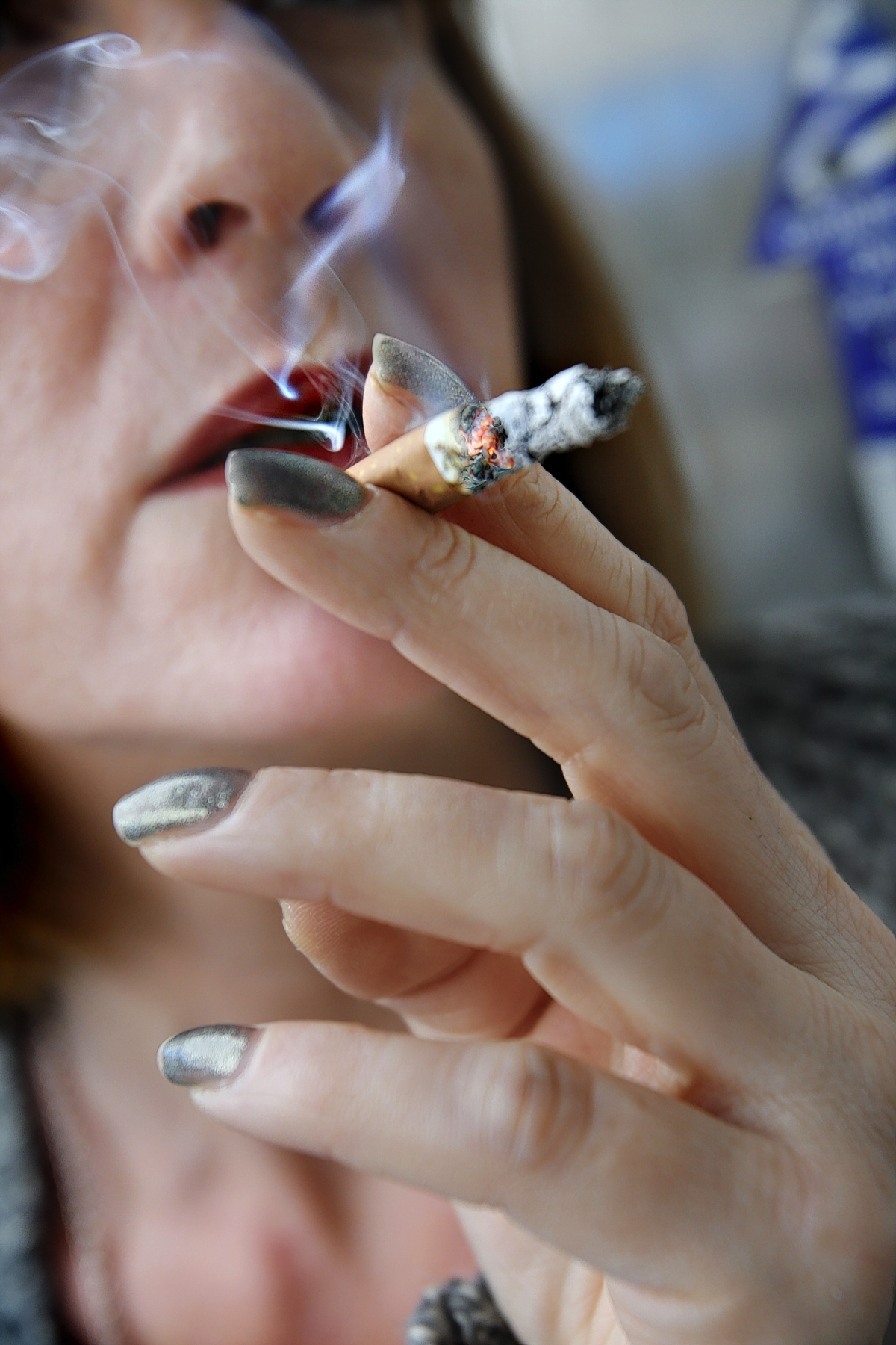 Smoking e-cigarettes at work sparks row