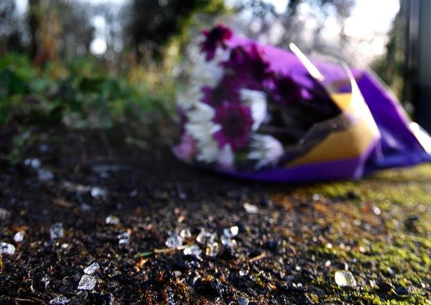 Flowers left at the crash scene in The Common, Stanmore.