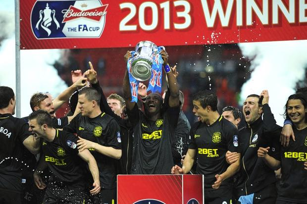 Wigan Athletic were the latest example of a cup giant-killing act as the Latics defeated Manchester City in last year's final. Picture: Action Images