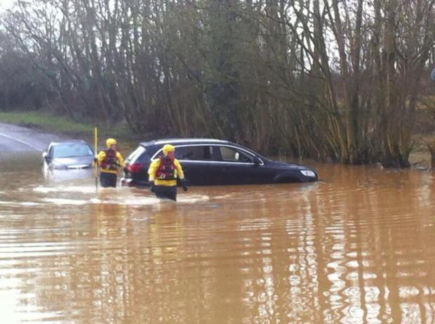 Fire crews rescue car from flooded Chorleywood street