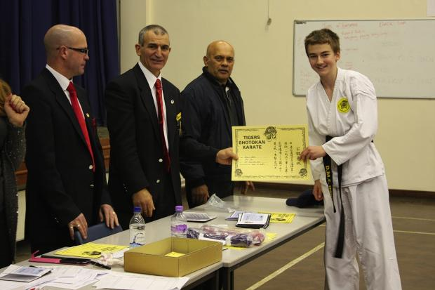 Bushey teen kicks his way to black belt