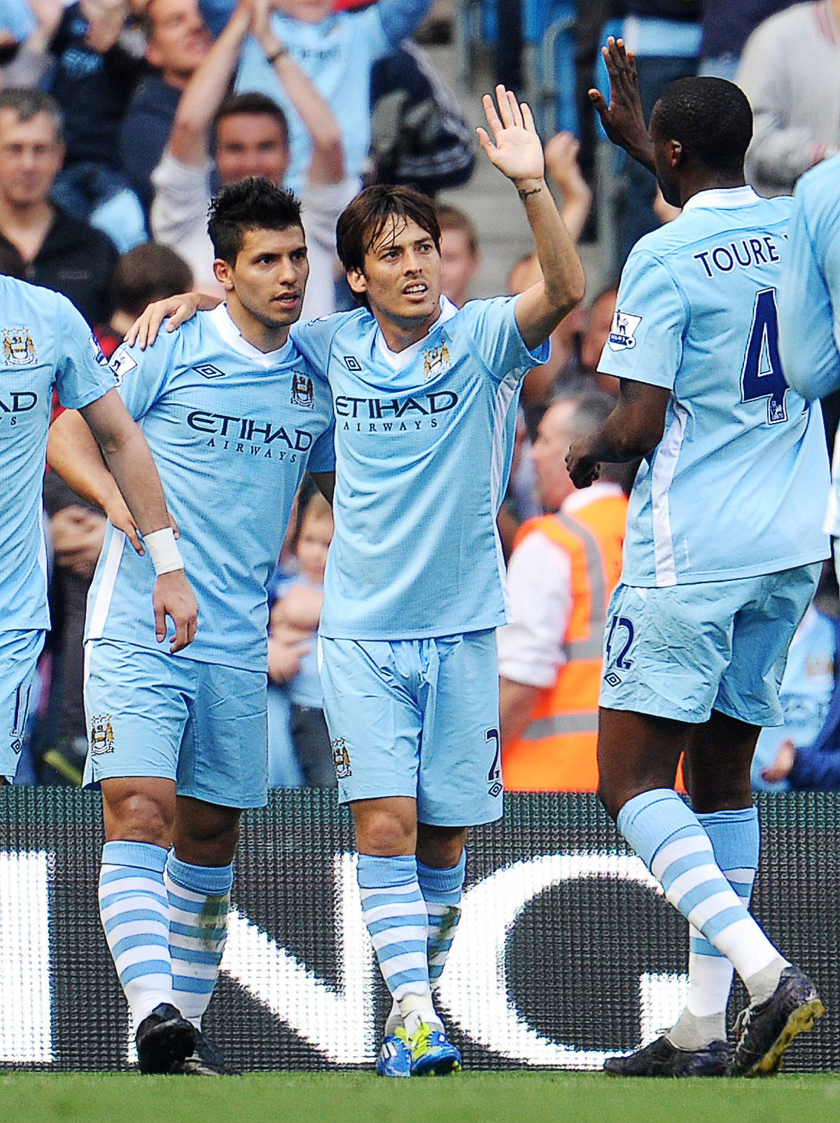 Manchester City's Sergio Aguero (L) celebrates with David Silva and Yaya Toure. Picture: Action Images