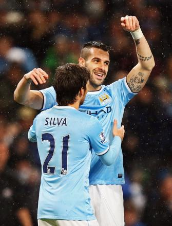 Absent tomorrow: Alvaro Negredo and David Silva. Picture: Action Images