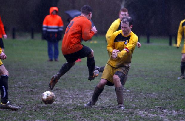 This could hurt: Shenley Wood (yellow shirts) eased through to the sixth round of the Herts Sunday Junior Cup. Picture: Holly Cant
