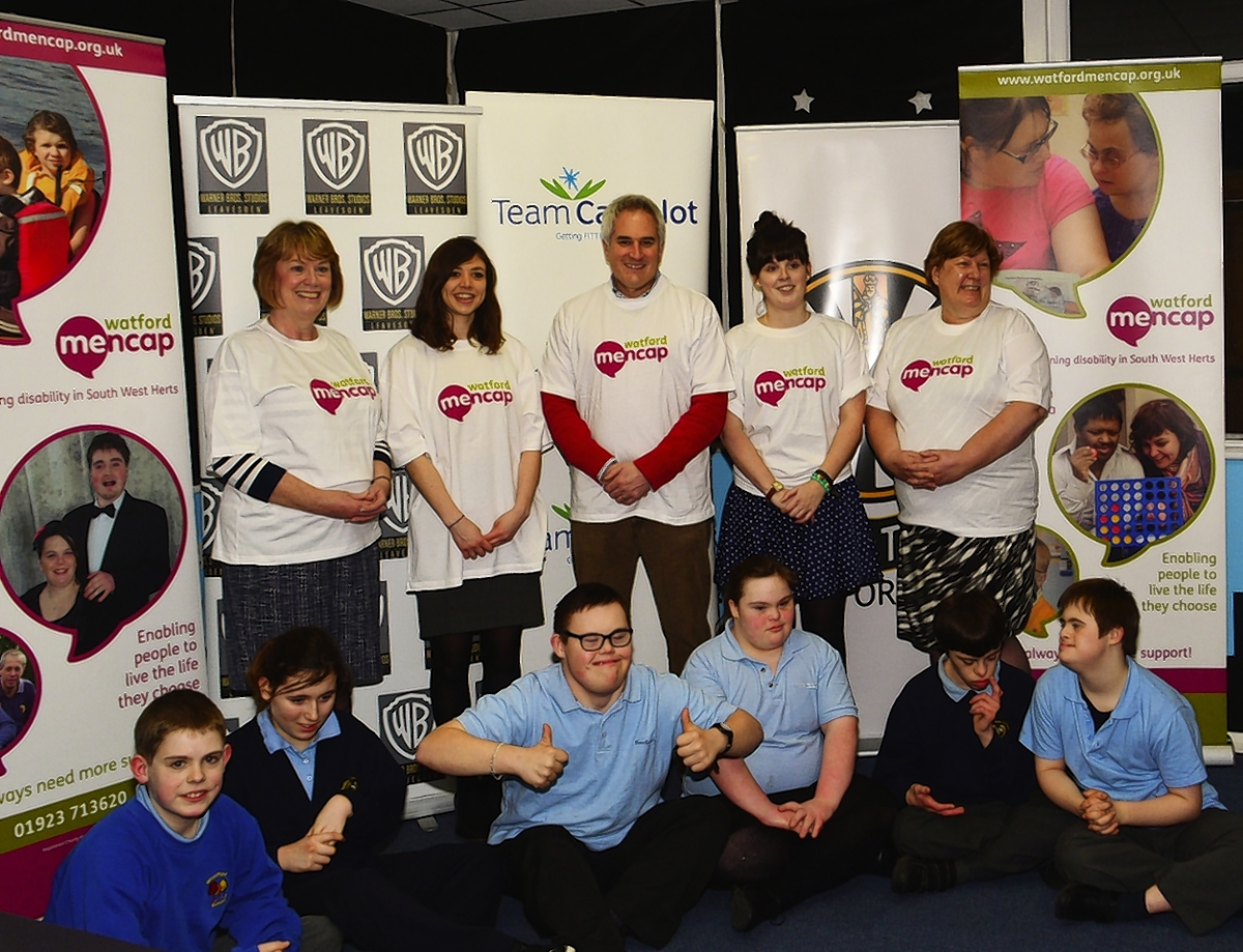 L-R Dorothy Thornhill, Ruth Horwitz, Camelot UK, Dan Dark Warner Bros. Studios Leavesden (WBSL), Rachel Schmitz, Watford Mencap, Carol Tunstall Watford Mencap, and children from the After School Club at Watford