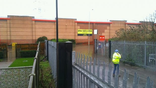 Flooding by Watford Arches Retail Park near Lower High Street. Picture by @maloneyRM
