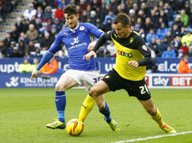 Watford's Daniel Tozser holds off Leicester City's David Nugent. Picture: Action Images