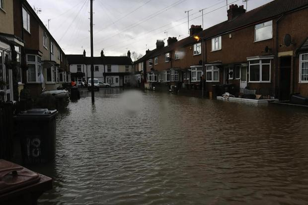 Watford Observer: Flooding in Arthur Street, Bushey. Picture by David McGovern.