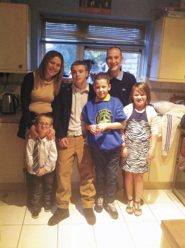 Watford Observer: Alex with wife Michelle and their children.