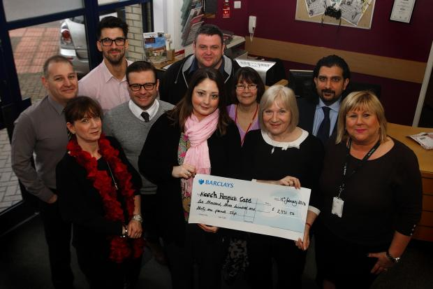 Fundraising success as Watford Observer staff hand over cheque to hospice