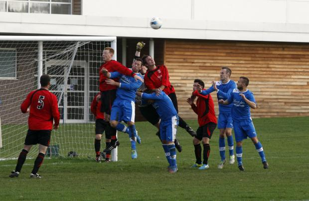 St Josephs (red shirts) in Watford Sunday League action. Picture: Holly Cant