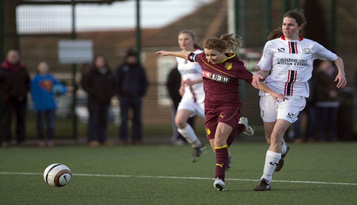 Sarah Wiltshire battles for the ball in Watford Ladies' 6-0 friendly win over MK Dons at the weekend.