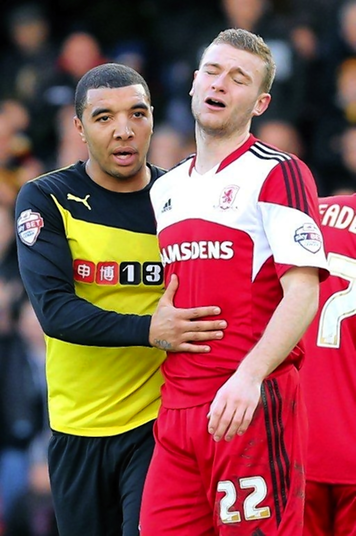 Watford striker Troy Deeney with Middlesbrough's Ben Gibson, who had just been sent off. Picture: Dave Peters.