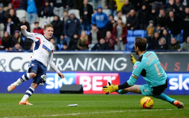 Joe Mason on his way to scoring Bolton Wanderers' second goal. Picture: Action Images